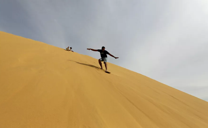 sand boarding. sand skiing, sand skiing in Egypt